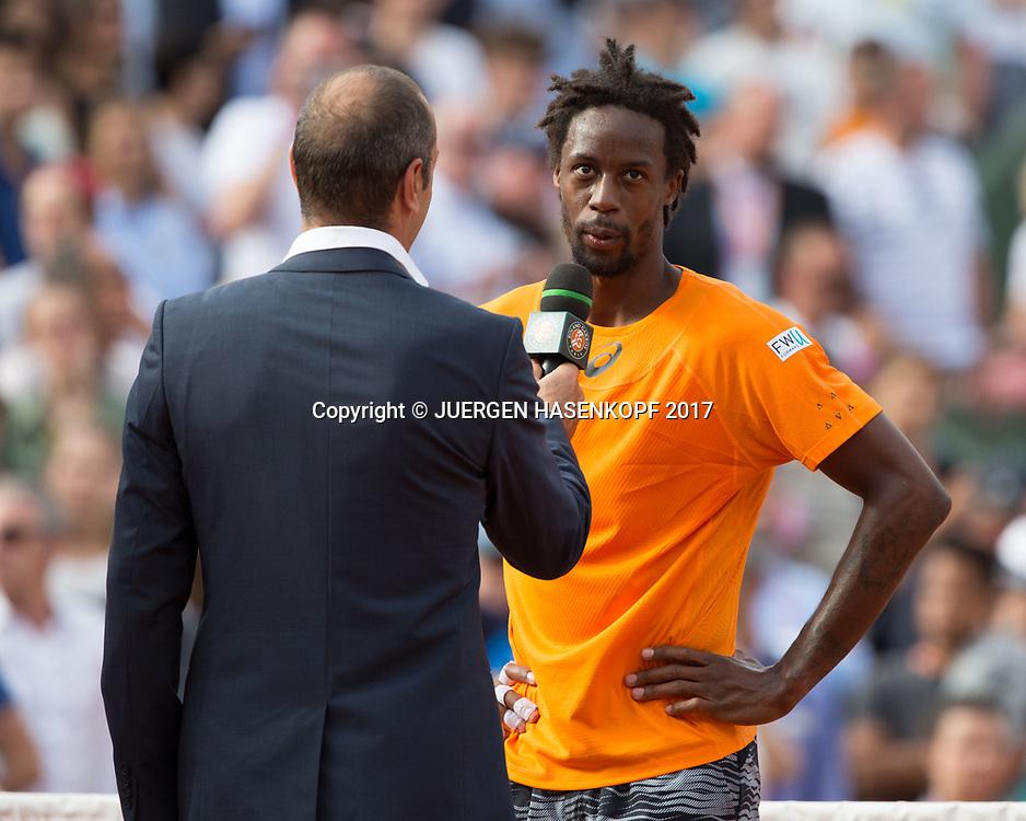 GAEL MONFILS (FRA) gibt ein TV Interview nach seinem Sieg,,Moderator Cedric Pioline,<br /> <br /> Tennis - French Open 2017 - Grand Slam ATP / WTA -  Roland Garros - Paris -  - France  - 30 May 2017.