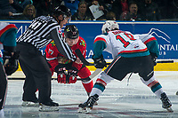 KELOWNA, CANADA - APRIL 7: Linesman Kevin Crowell drops the puck between Alex Overhardt #17 of the Portland Winterhawks and Dillon Dube #19 of the Kelowna Rockets on April 7, 2017 at Prospera Place in Kelowna, British Columbia, Canada.  (Photo by Marissa Baecker/Shoot the Breeze)  *** Local Caption ***