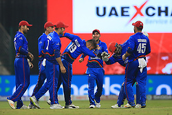 September 20, 2018 - Abu Dhabi, United Arab Emirates - Afghanistan cricketers celebrate after taking a wicket during the 6th cricket match of Asia Cup 2018 between Bangladesh and Afghanistan at the Sheikh Zayed Stadium,Abu Dhabi, United Arab Emirates on September 20, 2018. (Credit Image: © Tharaka Basnayaka/NurPhoto/ZUMA Press)