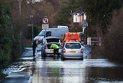 © Licensed to London News Pictures. 01/02/2014. Titchfield, Hampshire, UK. Broken down cars being assisted by the AA breakdown service in flood water from the River Meon, which is out of bank in Titchfield, Hampshire. There is wet and windy weather forecast for the UK today, 1st February 2014. Photo credit : Rob Arnold/LNP