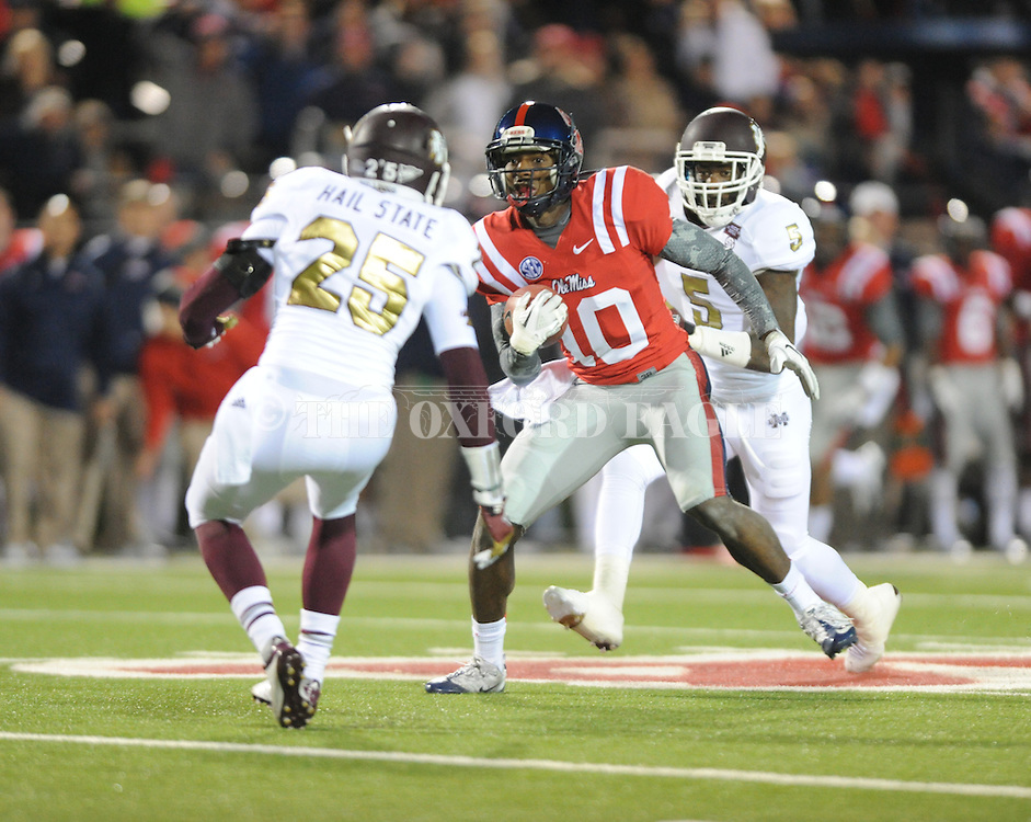 Ole Miss wide receiver Vince Sanders (10) makes a catch against Mississippi State defensive back Nickoe Whitley (5) and Mississippi State defensive back Corey Broomfield (25) at Vaught Hemingway Stadium in Oxford, Miss. on Saturday, November 24, 2012. Ole Miss won 41-24.