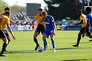 AFC Wimbledon attacker Marcus Forss (15) surrounded by Bristol Rovers players during the EFL Sky Bet League 1 match between AFC Wimbledon and Bristol Rovers at the Cherry Red Records Stadium, Kingston, England on 21 September 2019.