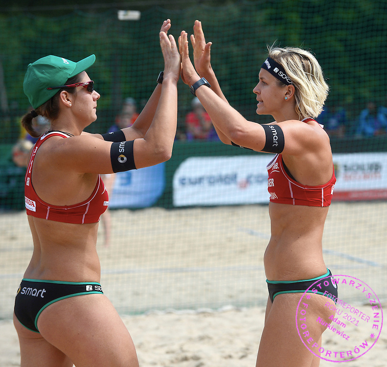 STARE JABLONKI POLAND - July 2: Laura Ludwig /1/ and Kira Walkenhorst of Germany in action during Day 2 of the FIVB Beach Volleyball World Championships on July 2, 2013 in Stare Jablonki Poland.  (Photo by Piotr Hawalej)