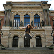 Victoria More jumps for joy on the steps of Uppsala University, the oldest center of higher education in Scandinavia. <br /> Photography by Jose More