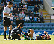 Dundee physio Karen Gibson gives treatment to Lewis Toshney  - Dundee v Motherwell, Clydesdale Bank Scottish Premier League at Dens Park.. - © David Young - 5 Foundry Place - Monifieth - DD5 4BB - Telephone 07765 252616 - email: davidyoungphoto@gmail.com - web: www.davidyoungphoto.co.uk