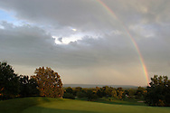 Hamptonburgh, NY  - A rainbow arcs across the sky behind Stony Ford Golf Course on Aug. 2, 2008.
