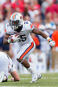 FAYETTEVILLE, AR - OCTOBER 24:  Peyton Barber #25 of the Auburn Tigers runs the ball against the Arkansas Razorbacks at Razorback Stadium Stadium on October 24, 2015 in Fayetteville, Arkansas.  The Razorbacks defeated the Tigers in 4 OT's 54-46.  (Photo by Wesley Hitt/Getty Images) *** Local Caption *** Peyton Barber