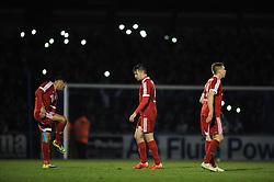 Aldershot Town's Brett Williams cuts a dejected figure as fans use their phones lights in the background  - Photo mandatory by-line: Dougie Allward/JMP - Mobile: 07966 386802 - 20/03/2015 - SPORT - Football - England - Memorial Stadium - Bristol Rovers v Aldershot - Vanarama Football Conference