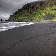 Vik, Iceland, is known for its beautiful black sand beaches and the signature formation Reynisdrangar (name for the basalt sea stacks seen in the water).