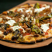 12/17/10 Wilmington DE: Paul and Young Ron Pizza served with Meatballs, Sausage, Hot or sweet peppers &amp; Ricotta chesse served at Anthony's Coal Fired Pizzas in Wilmington Delaware.<br /> <br /> Special to The News Journal/SAQUAN STIMPSON