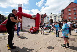 Exeter Chiefs Community Chiefs entertain fans at Exeter Quay as Exeter Chiefs players row Dragon Boats down the Quay wearing the new Home and European Kits for the 2019/20 Season - Ryan Hiscott/JMP - 19/07/2019 - SPORT - Exeter Quay - Exeter, England - Exeter Chiefs Kit Launch