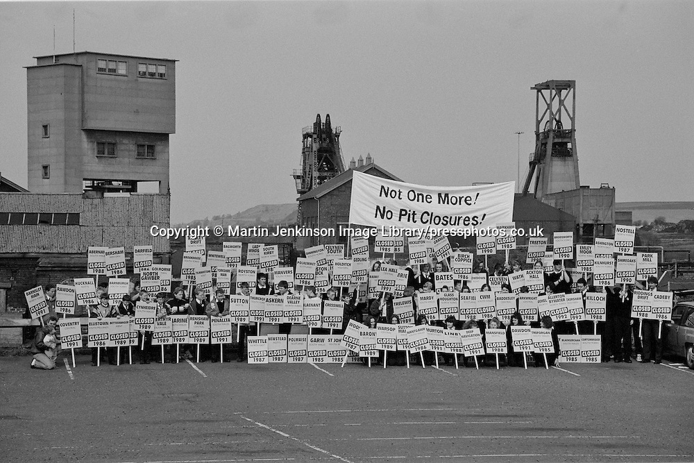 Pupils From Foulstone & Dearne High Schools hold up placards with the names of the 125 pits closed since 1985. In the background the closure threatened Houghton Main Pit. 26 March 1993