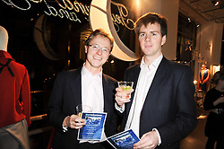 Left to right, CHARLIE SAVORY and THOMAS SUTTON at reception to raise funds for a Ugandan School Project supported by the Henry van Straubenzee Memorial Fund held at Few & Far, 242 Brompton Road, London SW3 on 11th February 2010.