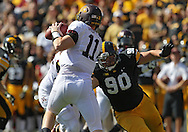 September 29 2012: Iowa Hawkeyes defensive lineman Louis Trinca-Pasat (90) tries to get to Minnesota Golden Gophers quarterback Max Shortell (11) during the first quarter of the NCAA football game between the Minnesota Golden Gophers and the Iowa Hawkeyes at Kinnick Stadium in Iowa City, Iowa on Saturday September 29, 2012. Iowa defeated Minnesota 31-13 to claim the Floyd of Rosedale Trophy.