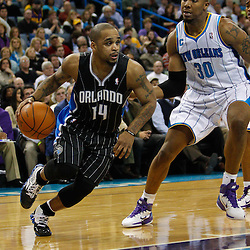 January 12, 2011; New Orleans, LA, USA; Orlando Magic point guard Jameer Nelson (14) drives past New Orleans Hornets power forward David West (30) during the second half at the New Orleans Arena. The Hornets defeated the Magic 92-89.  Mandatory Credit: Derick E. Hingle