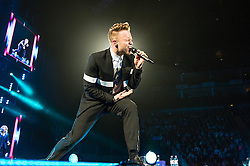 © Licensed to London News Pictures. 03/05/2015. London, UK.   Olly Murs performing live at The O2 Arena for the first of three headline shows at the O2 this week.   Olly Murs is an English singer-songwriter, musician, and television presenter. He rose to fame after finishing as the runner-up in the sixth series of The X Factor in 2009.  Photo credit : Richard Isaac/LNP