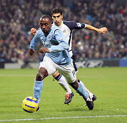MANCHESTER, ENGLAND - WEDNESDAY, JANUARY 4th, 2006: Manchester City's Darius Vassell and Tottenham Hotspur's Paul Stalteri during the Premiership match at the City of Manchester Stadium. (Pic by David Rawcliffe/Propaganda)