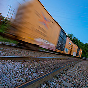 Moving freight trains and motion blur near Woodswether and Broadway in Kansas City, Missouri.