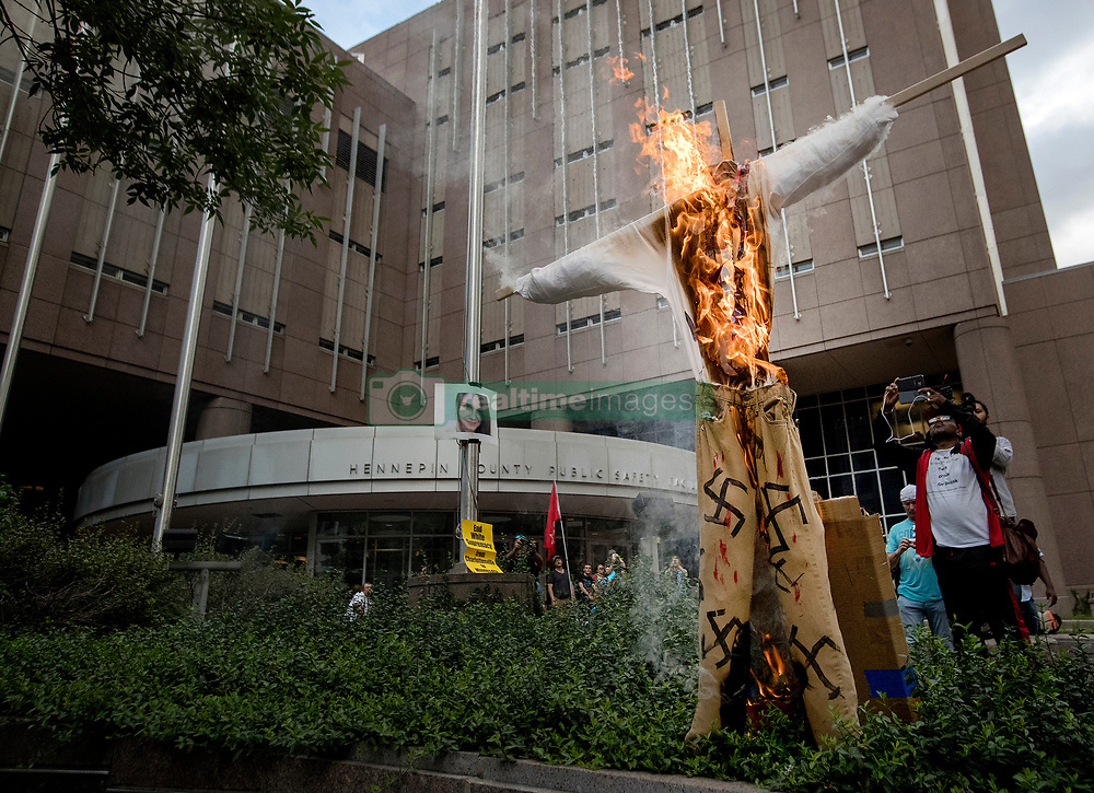 Demonstrators burn a swastika-covered figure during a march for solidarity with anti-racists in Charlottesville Monday, Aug. 14, 2017 that ended in downtown Minneapolis, MN, USA. Photo by Carlos Gonzalez/Minneapolis Star Tribune/TNS/ABACAPRESS.COM