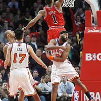 12 March 2012: Chicago Bulls point guard Derrick Rose (1) dunks the ball past New York Knicks point guard Baron Davis (85) during the Chicago Bulls 104-99 victory over the New York Knicks at the United Center, Chicago, Illinois, USA.