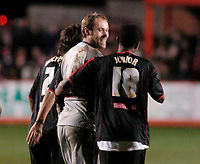 Photo: Leigh Quinnell.<br /> Tamworth v Stoke City. The FA Cup. 17/01/2006. Stoke keeper Steve Simonsen is congratulated by Junior after wining the penalty shoot out.