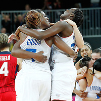 07 August 2012: France Sandrine Gruda, Endene Miyem and Jennifer Digbeu celebrate the win following 71-68 Team France victory over Team Czech Republic, during the women's basketball quarter-finals, at the Basketball Arena, in London, Great Britain.
