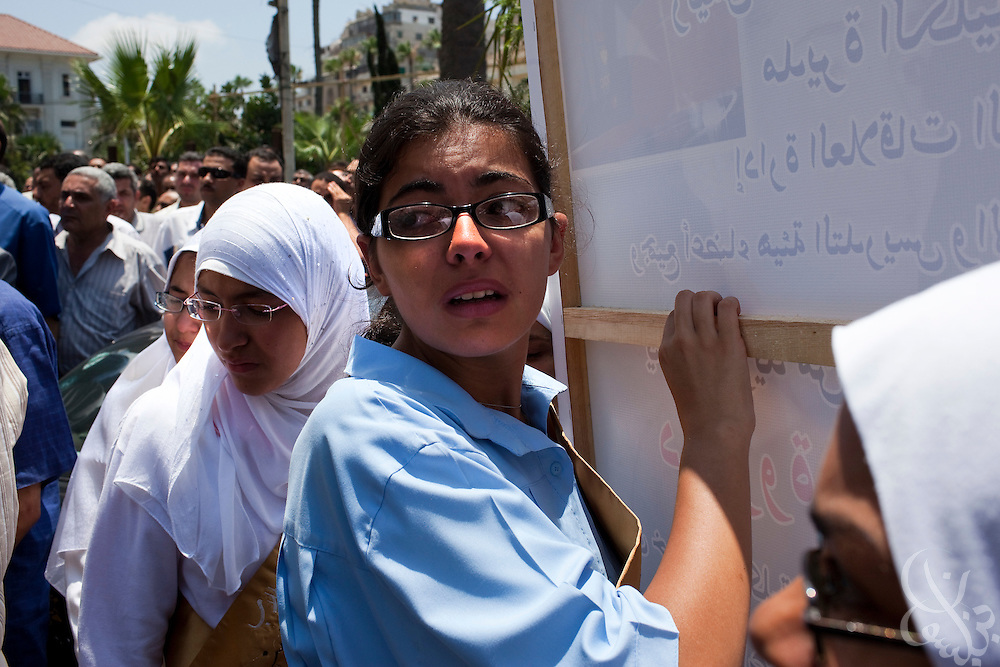 """Egyptian women mourn Marwa Sherbini, 31, at her funeral in the Egyptian port city of Alexandria July 6, 2009. Sherbini was stabbed to death inside a German courtroom by a 28 year old attacker, Axel W., who had been previously convicted of insulting her religion. Newspapers in Egypt have expressed outrage over the attack and have dubbed her the """"martyr of the hijab"""" and """"headscarf martyr."""""""