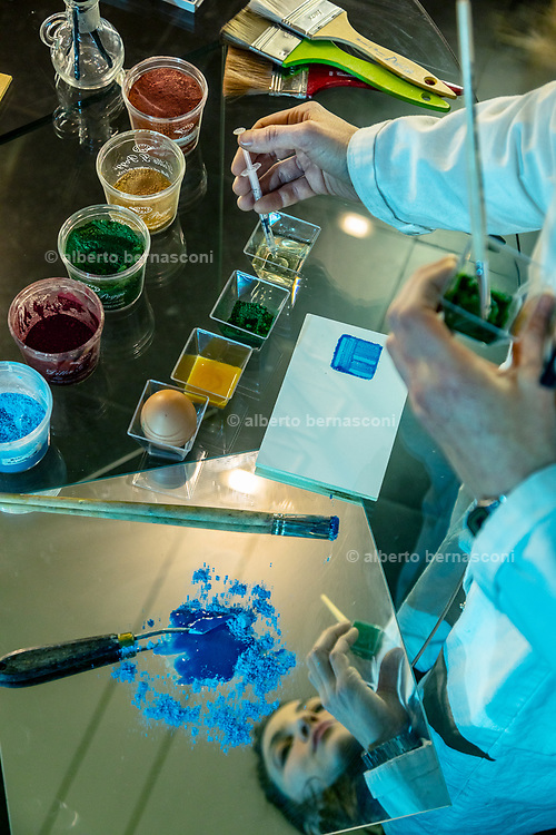Rome, the coservative studio Merlini Storti. classical painters used to add white vinegar to the pigment and egg yolk mix to prevent the tempera paint from rotting