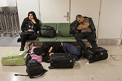 © licensed to London News Pictures. London, UK 29/10/2012. 3 passengers whose flights to Los Angles got cancelled, planning to spend over 24 hours at Heathrow Terminal 4 as flights to the east American coast cancelled from Heathrow Airport due to Hurricane Sandy. Photo credit: Tolga Akmen/LNP