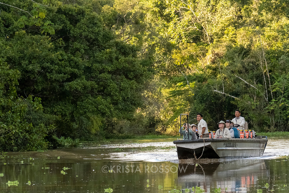 Naturalist Javier Arbildo looks for wildlife during a skiff excursion on Nauta Creek off of the Maranon River in the Peruvian Amazon.