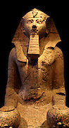 Large kneeling statue of Hatshepsut, Dynasty 18, (ca 1473-1458 BC) Joint reign of Hatshepsut and Thutmose 111.  Granite.  From Thebes, originally from Hatshepsut's temple att Deir el-Bahri.