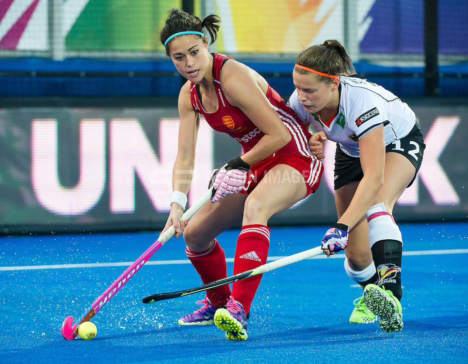 England's Sam Quek is tackled by Charlotte Stapenhorst of Germany. England v Germany - Unibet EuroHockey Championships, Lee Valley Hockey & Tennis Centre, London, UK on 26 August 2015. Photo: Simon Parker
