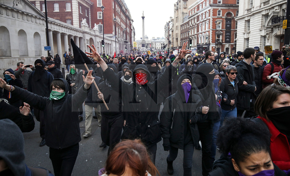 © Licensed to London News Pictures. 09/12/2018. London, UK. Anti-fascist protestors take part in a counter demonstration against Pro-Brexit protesters at the 'Brexit Betrayal' march in central London, led by far-right activist Tommy Robinson. Prime Minister Theresa May's proposed Brexit deal will be voted on by MPs in the coming week. Photo credit: Tom Nicholson/LNP