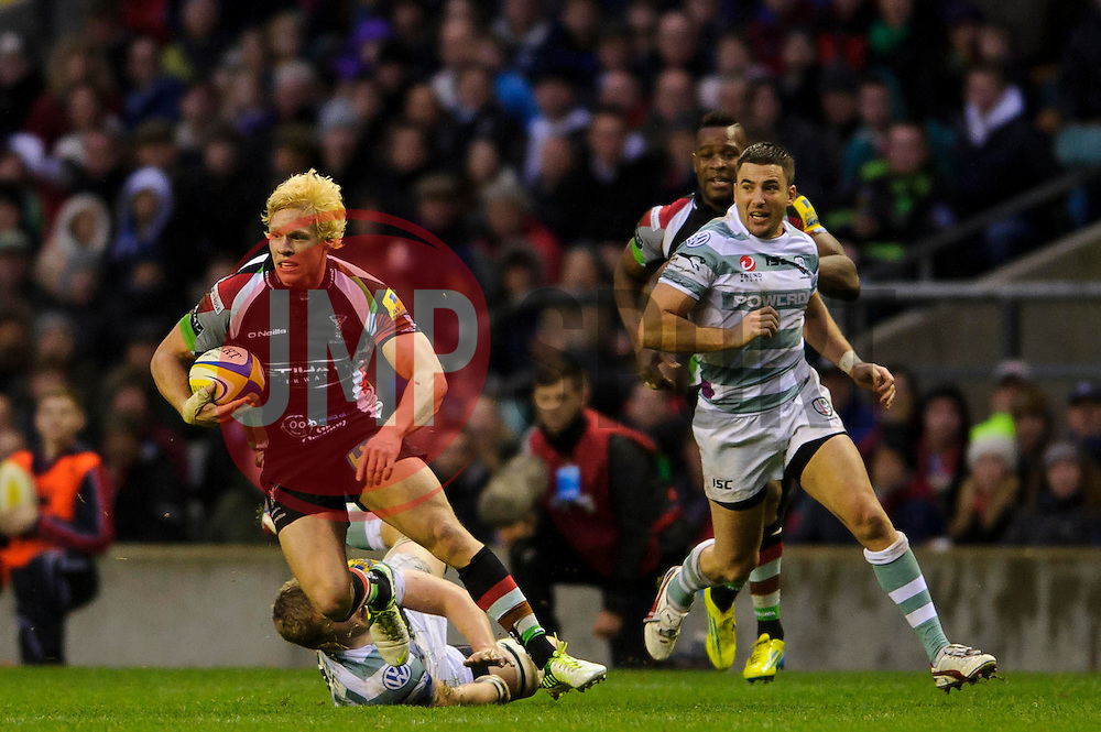 Harlequins Outside Centre (#13) Matt Hopper breaks from London Irish replacement (#20) Jamie Gibson during the second half of the match - Photo mandatory by-line: Rogan Thomson/JMP - Tel: Mobile: 07966 386802 29/12/2012 - SPORT - RUGBY - Twickenham Stadium - London. Harlequins v London Irish - Aviva Premiership - LV= Big Game 5.