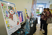 Student art contest finalists' work is displayed before the 2016 HISD holiday greeting card ceremony, where three winners were chosen - one from each grade level.