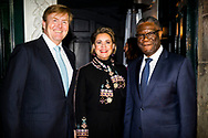 The Hague, 28 November 2018 - King Willem-Alexander, Grand Duchess Maria Teresa of Luxembourg and Dr. Denis Mukwege, a Congolese gynecologist and activist who operated on victims of sexual violence and fights worldwide against the use of rape as a weapon of war, before the start of a symposium. Dr. Denis Mukwege will receive the Nobel Peace Prize this year. Copyright Robin Utrecht