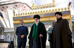 Iran's supreme leader, Ayatollah Ali Khamenei(C), prays over the tomb of the founder of Iran's Islamic republic, the late Ayatollah Ruhollah Khomeini (portrait), at the latter's shrine south of Tehran on January 31, 2018 to mark the 39th anniversary of his return from exile on February 1, 1979. Photo by Parspix/ABACAPRESS.COM