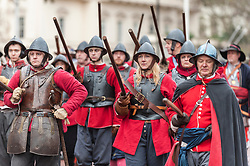 © Licensed to London News Pictures. 31/01/2016. London, UK. Members of The English Civil War Society, one of the oldest re-enactment groups in the world, bring to life The King´s Army (the Royalist half of the English Civil War Society) as they retrace the route taken by King Charles I from St James' Palace to the place of his execution at the Banqueting House in Whitehall. Photo credit : Stephen Chung/LNP
