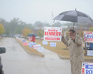 Rocky Kennedy holds a campaign sign as voters go to the polls in the rain at the Oxford Conference Center in Oxford, Miss. on Tuesday, November 2, 2010.