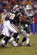 SAN DIEGO, CA - JANUARY 8:  Quarterback Chad Pennington #10 of the New York Jets gets sacked by linebackers Shaun Phillips #95, Steve Foley #53, and defensive end DeQuincy Scott #78 of the San Diego Chargers. Pennington still completed 23 of 33 passes for 279 yards and 2 touchdowns against the Chargers at Qualcomm Stadium on January 8, 2005 in San Diego, California. The Jets defeated the Chargers 20-17 in overtime in the AFC Wild Card Game. ©Paul Anthony Spinelli  *** Local Caption *** Chad Pennington; Shaun Phillips; Steve Foley; DeQuincy Scott