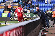 Middlesbrough Forward,  Jordan Rhodes celebrates with a supporter during the Sky Bet Championship match between Bolton Wanderers and Middlesbrough at the Macron Stadium, Bolton, England on 16 April 2016. Photo by Mark Pollitt.