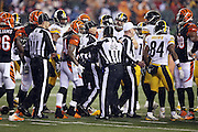 Cincinnati Bengals cornerback Adam Jones (24) complains to field judge Buddy Horton (82) as officials try to break up a melee during the NFL AFC Wild Card playoff football game against the Pittsburgh Steelers on Saturday, Jan. 9, 2016 in Cincinnati. The Steelers won the game 18-16. (©Paul Anthony Spinelli)