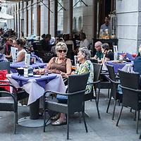 """People enjoy """"aperitivo"""" in a bar near Piazza dell'Unità d'Italia in Trieste, Italy."""