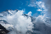 Jungfrau mountain (left) and Siberhorn (snowy triangle) in the Swiss Alps, Bernese Oberland, Switzerland