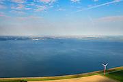 Nederland, Flevoland, Gemeente Almere, 27-08-2013; Almere-Pampus, Kustzone Almere. Zicht op het IJmeer met het forteiland Pampus, locatie voor een mogelijke IJmeerverbinding (IJmeerlijn). Foto richting IJburg, Amsterdam skyline en Waterland zichtbaar aan de horizon.<br /> Windmills along the coast in Almere Poort, viewed in direction Amsterdam. Isle of Pampus (fortress) in the middle of the IJmeer (water).  <br /> luchtfoto (toeslag op standaard tarieven);<br /> aerial photo (additional fee required);<br /> copyright foto/photo Siebe Swart.