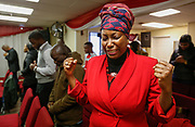 Adriel Matshoba prays during service at The Redeemed Christian Church of God Covenant House on Sunday, December 18, 2016.