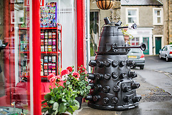 © Licensed to London News Pictures. 26/06/2015. Settle, UK. Picture shows a Dalek made from flower pots at Settle flower pot festival. The market town of Settle in the Yorkshire Dales is set to go flower pot mad over the weekend with the second Flower Pot Festival taking place. Locals in the town use the flower pots to make men, snakes, dogs, spiders & even a darlek.  Photo credit : Andrew McCaren/LNP