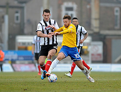 Bristol Rovers' Matty Taylor is challenged by Grimsby's Craig Clay - Photo mandatory by-line: Neil Brookman/JMP - Mobile: 07966 386802 - 14/02/2015 - SPORT - Football - Cleethorpes - Blundell Park - Grimsby Town v Bristol Rovers - Vanarama Football Conference
