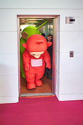 © Licensed to London News Pictures. 24/01/2017. LONDON, UK.  Toy Fair 2017 trade exhibition at Olympia.   In this picture: Teletubbies exiting a lift. Photo credit: Cliff Hide/LNP