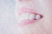 close up of mouth with halftone print dots and Japanese lettering